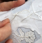 Appliqued lace along the bottom of Kate Middleton's wedding dress.